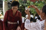Ketut's mom receiving a blessing